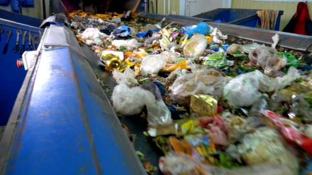 Sorting conveyor belt in a recycling plant. video