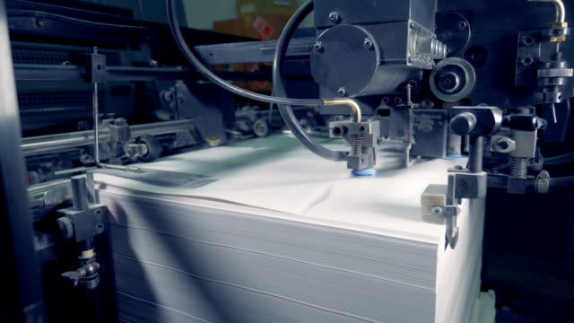 a sorting machine at a factory, close up. paper recycle process. - мембрана клетки стоковые видео и кадры b-roll