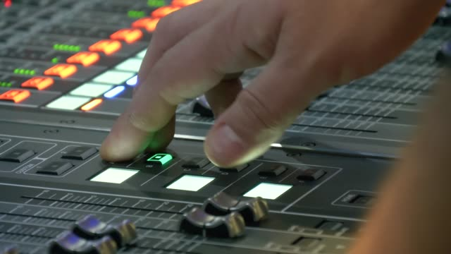 Sound control panel professional Hands control professional sound console. Sound control panel professional. Sound designer working on the sound control. sound recording equipment stock videos & royalty-free footage