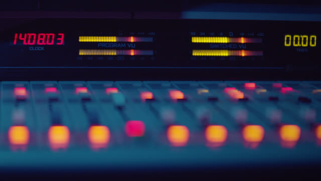 Sound Engineer is Working With Sound Control Desk in Studio