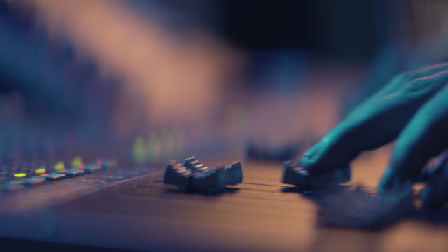 sound engineer is working with sound control desk in studio - spingere video stock e b–roll