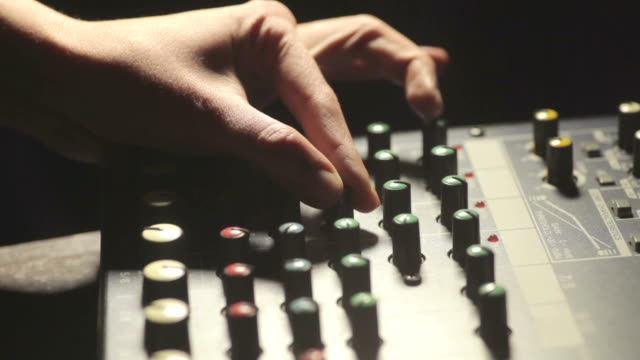 Sound mixer and hand adjusting buttons video