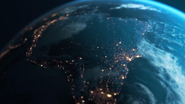 south america at night - planet earth seen from space - континент географический объект стоковые видео и кадры b-roll
