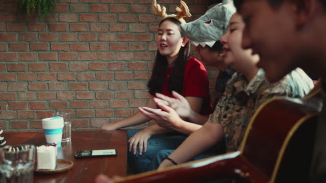 South east of asian group of Influencer playing music and broadcasting a story via live camera setting