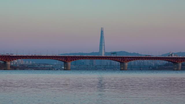 South Korea Bridge Time lapse of Seoul City skyline at Bridge and river in Seoul, South Korea. namsan seoul stock videos & royalty-free footage