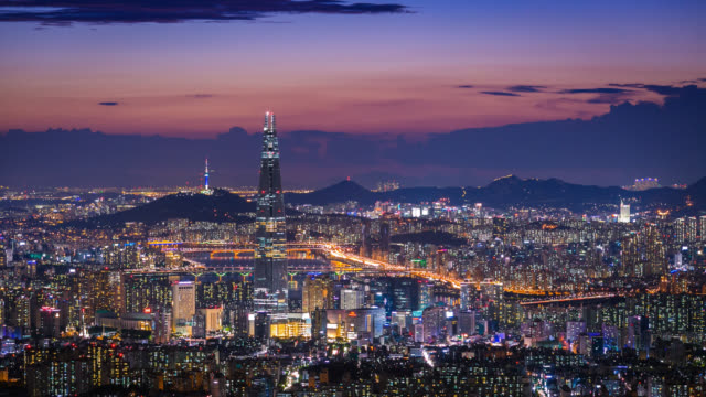 South Korea skyline of Seoul City, The best view of South Korea with Lotte world mall at Namhansanseong Fortress. South Korea skyline of Seoul City, The best view of South Korea with Lotte world mall at Namhansanseong Fortress. south korea stock videos & royalty-free footage