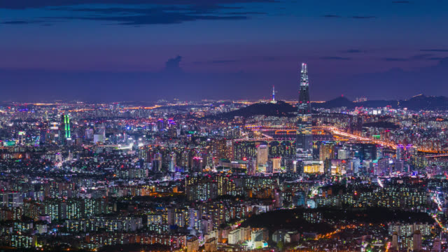 South Korea skyline of Seoul City, The best view of South Korea with Lotte world mall at Namhansanseong Fortress. South Korea skyline of Seoul City, The best view of South Korea with Lotte world mall at Namhansanseong Fortress. namsan seoul stock videos & royalty-free footage