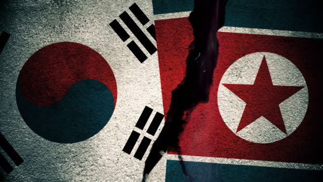 """South Korea vs North Korea Flags on Cracked Wall Flags """"versus"""" concept series south korea stock videos & royalty-free footage"""