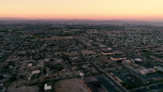 South Mountain Village Streets Aerial Outside Phoenix Arizona Drone shot above dessert valley neighborhoods at sunset with city skyline background south stock videos & royalty-free footage