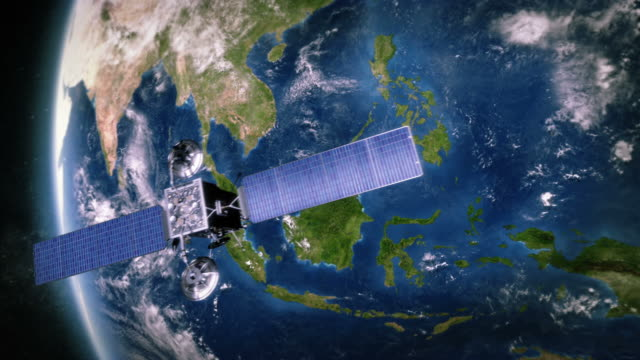 South-East Asia. Telecommunication satellite orbiting Earth. video