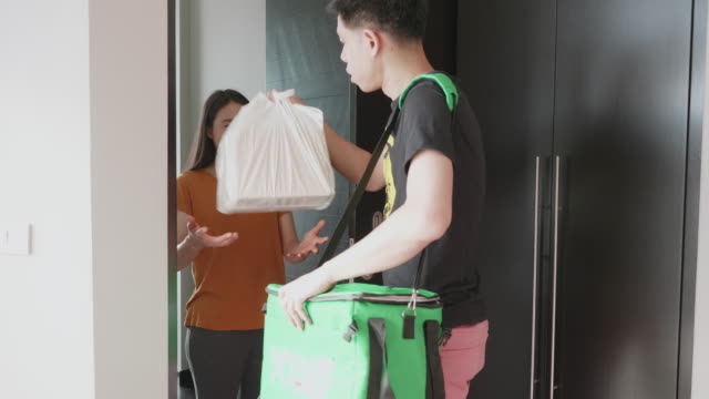 Southeast asian man delivery food to customer from door to door service