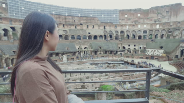 Southeast asian young woman take a sight seeing inside the 2nd floor of Colosseum