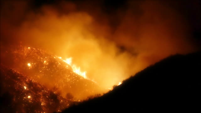 Southern California Fires at Night on Hillside 130b Night shot of hillside from the recent fires in Southern California. This clip was taken near Magic Mountain in Valencia, CA. HD 1080. california stock videos & royalty-free footage