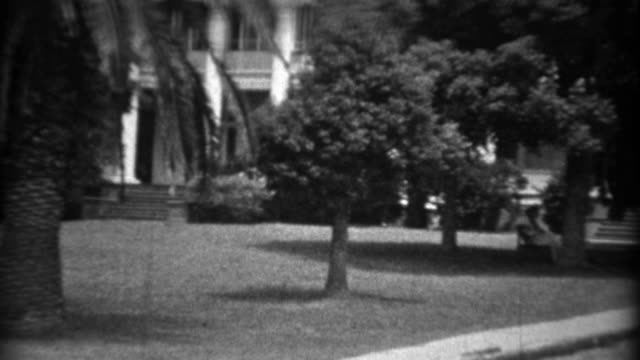 1934: Southern mansion home classic 1930's cars parked on street. video