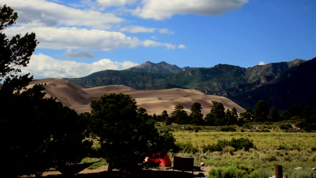 Southwest Colorado Great Sand Dunes National Park Timelapse Sangre De cristo mountains and clouds moving outdoor paradise camping