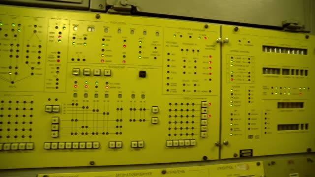 soviet control panel for launching intercontinental ballistic missiles Inside the underground Soviet military bunker, Soviet underground command post, inside the old soviet base, old soviet military base nuclear missile stock videos & royalty-free footage