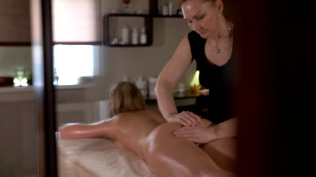 Spa massage. Aromatherapy oil massage. Masseur doing aromatherapy oil massage on beautiful young healthy caucasian woman body in spa salon video
