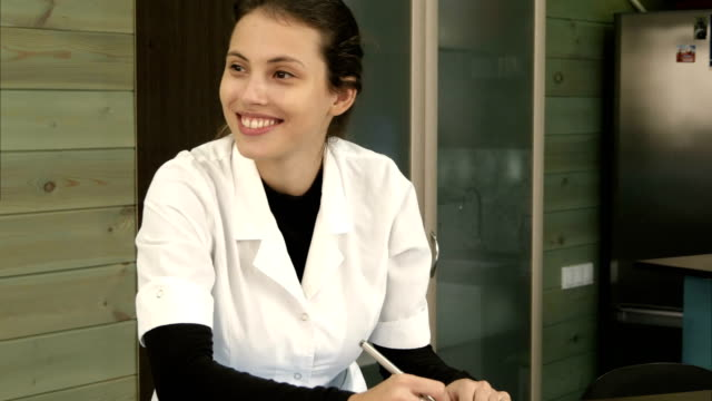 A spa receptionist greeting a female customer at the welcome desk video