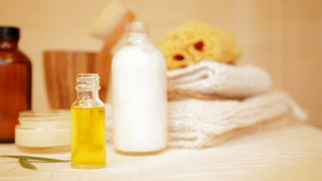 Spa still life of massage oil, and moisturizer