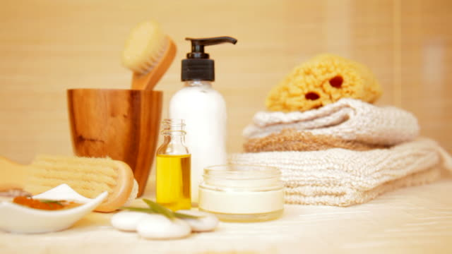 Spa still life of massage oil, moisturizer and towels  massage oil stock videos & royalty-free footage
