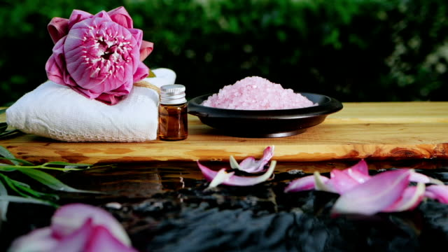 spa zen relaxation with pink waterlily lotus and pink himalayan salt on water slowmotion flowing , keep and calm meditation , work life balance concept spa zen relaxation with pink waterlily lotus and pink himalayan salt on water slowmotion flowing , keep and calm meditation , work life balance concept lotus position stock videos & royalty-free footage
