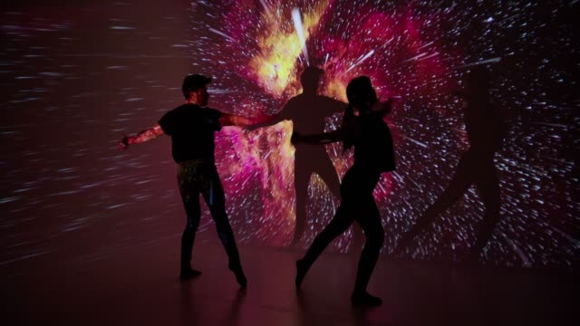 Space projection upon dancer couple