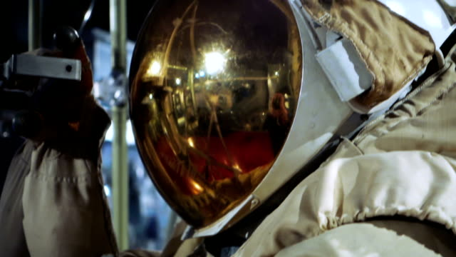 Space suit with gold coated visor video