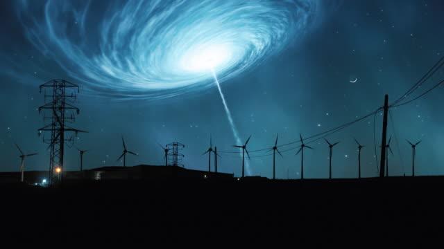 Space tornado. Wind turbines silhouettes