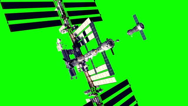4k. spacecraft docking to international space station. green screen. - pojęcia i zagadnienia filmów i materiałów b-roll