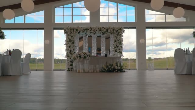 spacious hall with decorated tables for wedding celebration video