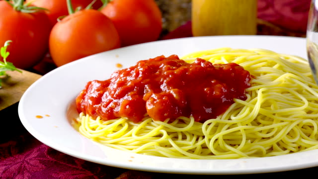 Spaghetti Dolly shot of Spaghetti with Tomato Sauce. spaghetti stock videos & royalty-free footage