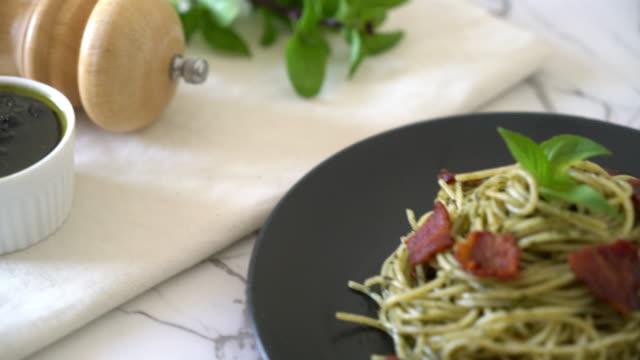 Spaghetti with basil pesto and bacon Spaghetti with basil pesto and bacon pesto sauce stock videos & royalty-free footage