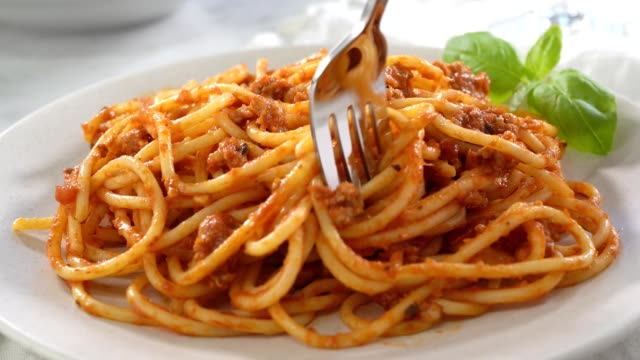 Spaghetti with Meat Sauce A plate of delicious spaghetti with meat sauce with pasta twirling on fork. spaghetti stock videos & royalty-free footage
