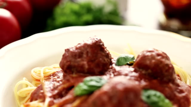 Spaghetti with meatballs Spaghetti with meatballs in tomato sauce spaghetti stock videos & royalty-free footage