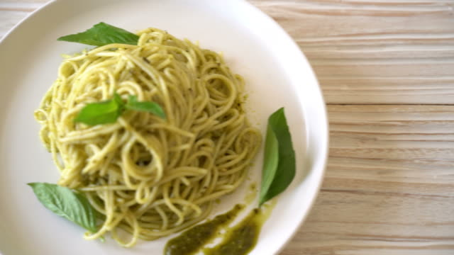 spaghetti with pesto sauce, olive oil and basil spaghetti with pesto sauce, olive oil and basil pesto sauce stock videos & royalty-free footage