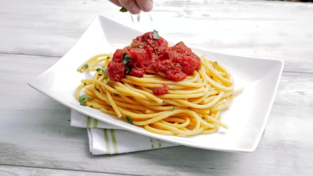 spaghetti with tomato sauce - italian food stock videos & royalty-free footage