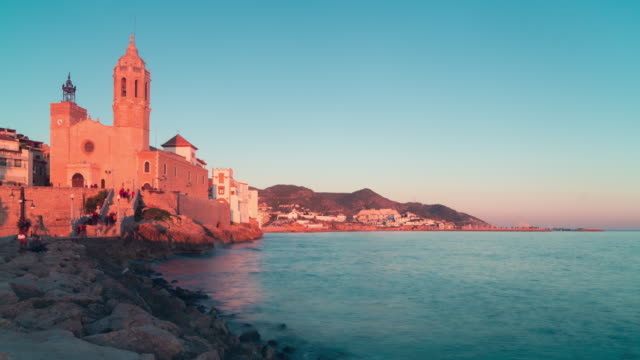 spain sitges sunset church bay view 4k time lapse video