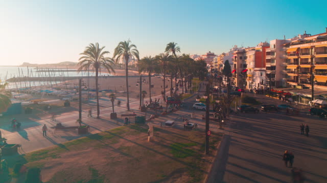 spain sitges sunset panoramic view on tourist walking bay square 4k time lapse video