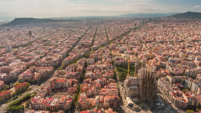 spain summer day barcelona cityscape sagrada familia aerial panorama 4k time lapse video