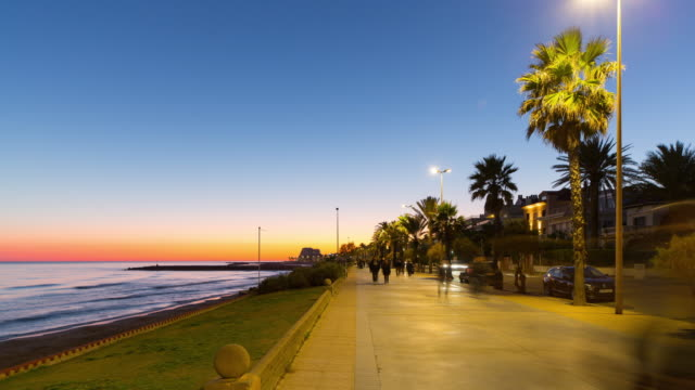 spain sunset sky sitges walking bay 4k time lapse video
