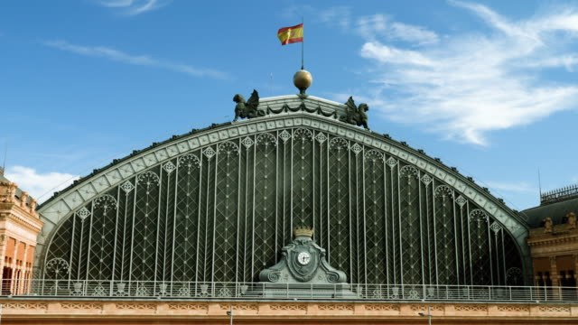 Spanish architecture. Exterior view of an old beautiful building of railway station in Madrid. 4K