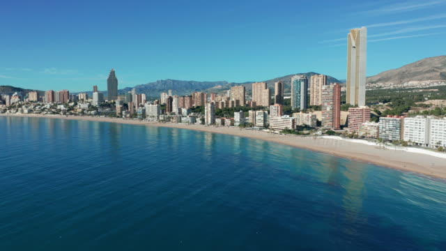 Spanish city Benidorm buildings and sandy beach Poniente. Aerial view