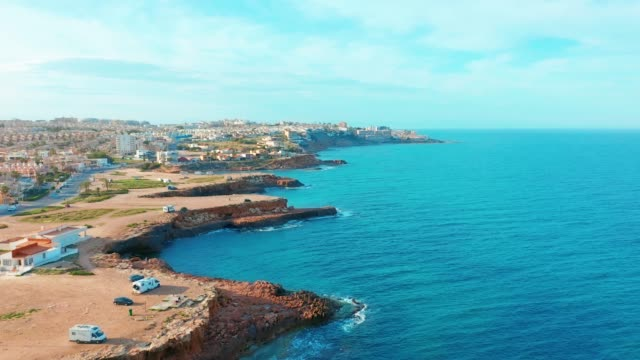 spanish coast line, alicante a town in the community of valencia and the province of costa blanca alicante spain europe , aerial 4k cinematic - испания стоковые видео и кадры b-roll