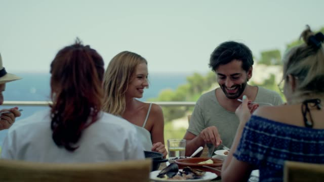 Spanish Local lunch with a view Group of friends eating lunch. Local dishes, healthy food. Seafood Paella. shrimp seafood stock videos & royalty-free footage