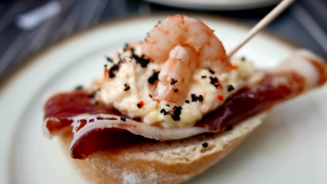 Spanish Tapas, pinchos. Small typical dishes. version 2 Small savory dishes, typically served with drinks at a bar. aperitif stock videos & royalty-free footage