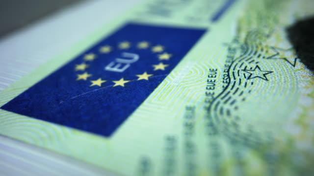 Spanish visa in foreign passport. Schengen visa in document. Travelling concept Closeup spanish visa in foreign passport. Macro shot schengen visa in document. Page in passport for immigration to European union. Detailed view visa stamp in passport, travel concept schengen agreement stock videos & royalty-free footage