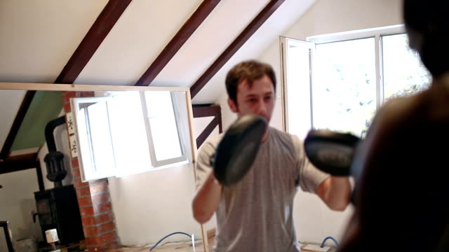 Sparing with partner, punching in punching mitts video