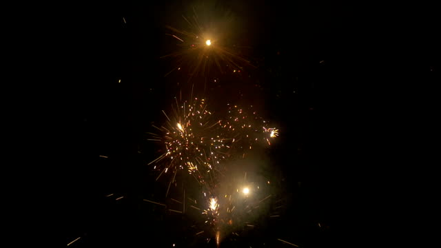 Sparkler Cracker Firework Slow Motion Firework sparkle isolated on a black background in slow motion firework explosive material stock videos & royalty-free footage