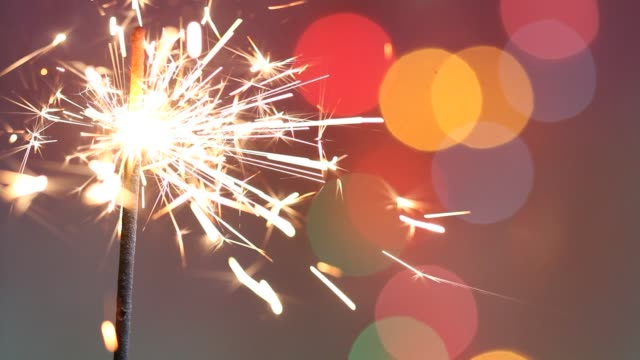 Sparkler stick on abstract colorful christmas new year party birthday background