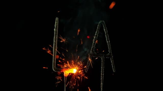 SLO MO LD Sparklers shaped as abbreviation 'LA' emitting sparks